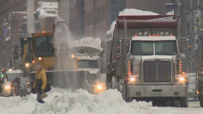 Snow removal trucks cart away snow in Montreal Dec. 30, 2015.