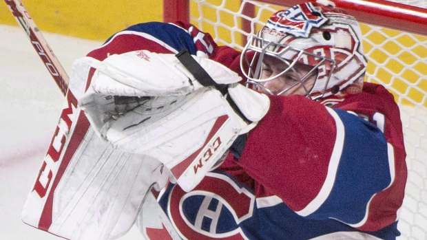 Montreal Canadiens goaltender Carey Price makes a save against the Toronto Maple Leafs during thrid period NHL hockey action in Montreal, Saturday, October 24, 2015. (Graham Hughes / THE CANADIAN PRESS)