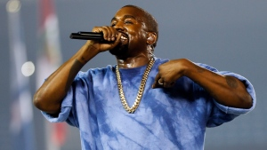 In this July 26, 2015, file photo, Kanye West performs during the closing ceremony of the Pan Am Games in Toronto. Kanye West, Beck, the Strokes and the Killers are set to perform at the three-day 2016 Governors Ball Music Festival in June. (AP Photo / Julio Cortez, File)