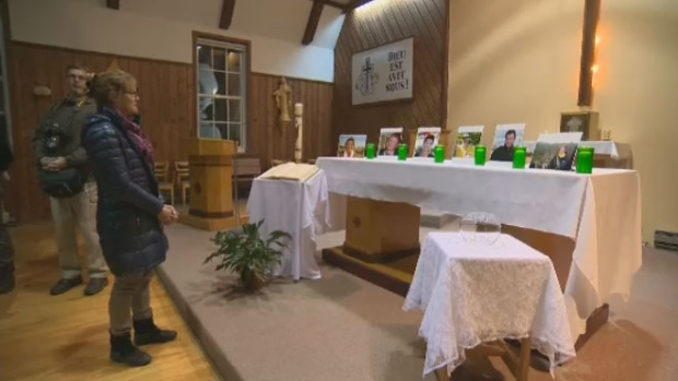 Friends and family of the victims gathered at the chapel in Lac-Beauport.