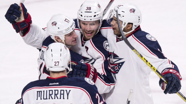 Columbus Blue Jackets' Brandon Dubinsky (17) celebrates his goal against the Montreal Canadiens with teammates Boone Jenner, centre, Seth Jones, right, and Ryan Murray during second period NHL hockey action, in Montreal, on Tuesday, Jan. 26, 2016. THE CANADIAN PRESS/Paul Chiasson