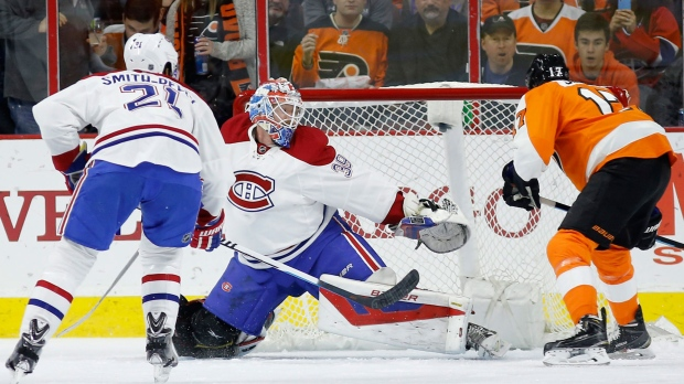 Philadelphia Flyers' Wayne Simmonds, right, scores a goal past Montreal Canadiens' Mike Condon, center, as Devante Smith-Pelly looks on during the first period of an NHL hockey game, Tuesday, Feb. 2, 2016, in Philadelphia. (AP Photo/Matt Slocum)