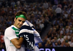 Roger Federer of Switzerland wipes the sweat from his face during his semifinal match against Novak Djokovic at the Australian Open tennis championships in Melbourne, Australia, Thursday, Jan. 28, 2016.(AP/Andrew Brownbill)