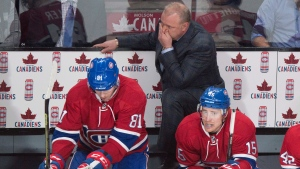 Montreal Canadiens head coach Michel Therrien and players Lars Eller, left, and Tomas Fleischmann watch the final minutes of the third period as they face the Buffalo Sabres in NHL hockey action Wednesday, February 3, 2016 in Montreal. The Sabres beat the Canadiens 4-2. THE CANADIAN PRESS/Paul Chiasson