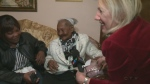 CTV reporter Caroline Van Vlaardingen gets a blessing from Cicilia Laurent, who is possibly the world's oldest living person.