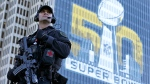 San Francisco Police tactical unit officer Jeff McHale watches the crowd at Super Bowl City Tuesday, Feb. 2, 2016 in San Francisco.  (AP / Charlie Riedel)