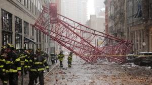 A collapsed crane lies on the street, in New York on Friday, Feb. 5, 2016. (AP / Bebeto Matthews)