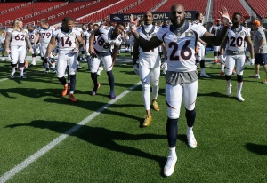 Denver Broncos free safety Darian Stewart (26) gestures after posing for team photos before an NFL football walk through practice in Santa Clara, Calif., Saturday, Feb. 6, 2016. (Jeff Chiu/AP)
