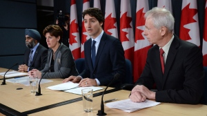 Defence Minister Harjit Sajjan, left to right, International Development Minister Marie-Claude Bibeau, Prime Minister Justin Trudeau and Foreign Affairs Minister Stephane Dion attend a news conference in Ottawa on Monday, Feb. 8, 2016.  (Sean Kilpatrick / THE CANADIAN PRESS)