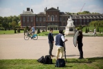 In this file photo, broadcasters report outside the residences of Kate Duchess of Cambridge and Prince William at Kensington Palace in London, Monday, Sept. 8, 2014. (AP/Matt Dunham)