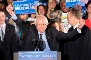 Democratic presidential candidate, Sen. Bernie Sanders, I-Vt., reacts to the cheering crowd at his primary night rally Tuesday, Feb. 9, 2016, in Manchester, N.H. (AP / J. David Ake)