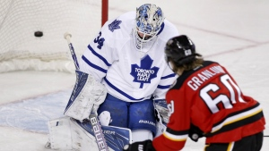 Calgary Flames' Markus Granlund scores a shorthanded goal on Toronto Maple Leafs goalie James Reimer during first period NHL action in Calgary, Alta. on Tuesday Feb. 9, 2016. (Larry MacDougal / THE CANADIAN PRESS)