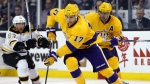 Los Angeles Kings' Milan Lucic skates past Boston Bruins' Brad Marchand during the third period of the Los Angeles Kings 9-2 win over the Boston Bruins in an NHL hockey game in Boston on Tuesday, Feb. 9, 2016. (AP / Winslow Townson)