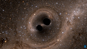 Two black holes are shown colliding in this computer-generated simulation from the Laser Interferometer Gravitational-Wave Observatory. (LIGO)