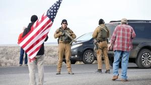 Authorities wait at the Narrows roadblock near the Malheur National Wildlife Refuge, Thursday, Feb. 11, 2016, near Burns, Ore. (Thomas Boyd/The Oregonian via AP)