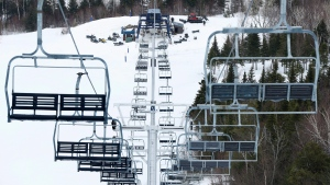 In this March 26, 2015 file photo, workers repair the King Pine chairlift at Sugarloaf Mountain Ski Resort in Carrabassett Valley, Maine. (AP Photo/Robert F. Bukaty)