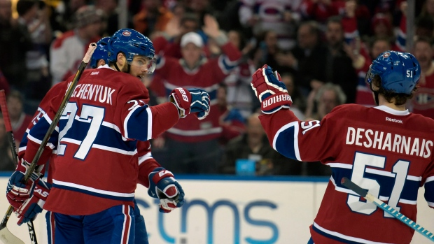 Montreal Canadiens' Alex Galchenyuk (27) celebrates his goal with teammate David Desharnais (51) during the second period of an NHL hockey game against the Buffalo Sabres , Friday, Feb. 12, 2016, in Buffalo, N.Y. (AP Photo/Gary Wiepert)