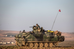 A Turkish army tank stands in Esme village in Aleppo province, Syria, Sunday, Feb. 22, 2015. (AP/Mursel Coban, Depo Photos)