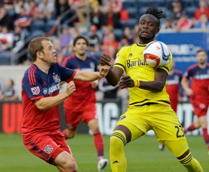 Columbus Crew forward Kei Kamara, right, controls the ball against Chicago Fire midfielder Harry Shipp during the first half of an MLS soccer match on July 15, 2015, in Bridgeview, Ill. (Nam Y. Huh / AP Photo)