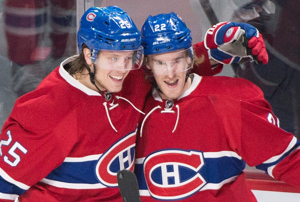 Montreal Canadiens' Dale Weise (22) celebrates with teammate Jacob De La Rose (25) after scoring against the Philadelphia Flyers during first period NHL hockey action in Montreal, Friday, February 19, 2016. THE CANADIAN PRESS/Graham Hughes