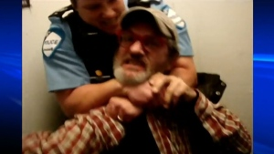 Former Montreal police officer Stefanie Trudeau is seen choking Serge Lavoie on Oct. 2, 2012.