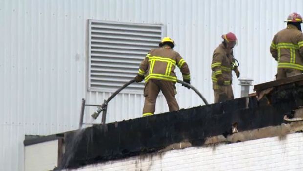 Firefighters on the roof of the Clic warehouse