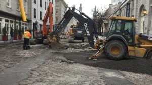 Construction crews work on St. Paul St. in Old Montreal (CTV Montreal/JL Boulch)