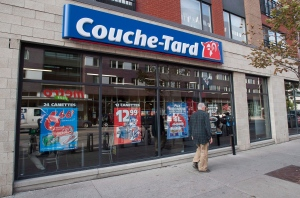 A man passes by a Couche-Tard convenience store in Montreal, on October 5, 2012. (Graham Hughes/THE CANADIAN PRESS)