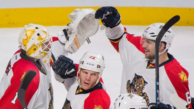 Florida Panthers goaltender Roberto Luongo, left, celebrates with teammates Alex Petrovic (6) and Shawn Thornton (22) after the Panthers defeated the Montreal Canadiens 4-1 in an NHL hockey game in Montreal, Tuesday, April 5, 2016. (Graham Hughes/The Canadian Press)