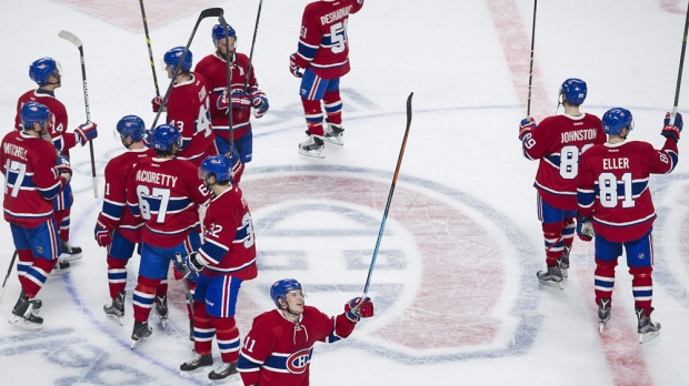 Montreal Canadiens players salute their fans following their win over the Tampa Bay Lightning in an NHL hockey game in Montreal, Saturday, April 9, 2016. THE CANADIAN PRESS/Graham Hughes