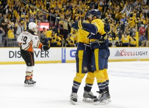 Nashville Predators defenseman Shea Weber, right, celebrates with center Paul Gaustad as Anaheim Ducks right wing Chris Stewart (29) skates away after Weber scored an empty-net goal in the final seconds of the third period to give the Predators a 3-1 win in Game 6 of an NHL hockey first-round Stanley Cup playoff series Monday, April 25, 2016, in Nashville, Tenn. (Mark Humphrey / AP Photo)