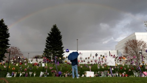 A rainbow appears over Paisley Park near a memorial for Prince, on April 21, 2016, in Chanhassen, Minn. (Carlos Gonzalez / Star Tribune via AP)