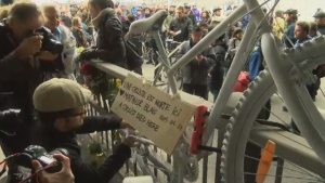 A sign in memory of cyclist Mathilde Blais is hung up on the railing near the overpass where she died two years ago.