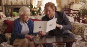 Queen Elizabeth sits next to her grandson, Prince Harry, in a video posted to Twitter on Friday, April 29, 2016.