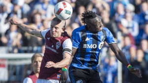 Colorado Rapids midfielder Sam Cronin heads the ball away from Montreal Impact forward Dominic Oduro during second half MLS action Saturday, April 30, 2016 in Montreal. THE CANADIAN PRESS/Paul Chiasson
