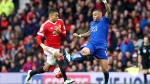 Manchester United's Jesse Lingard, left, and Leicester City's Danny Simpson in action during their English Premier League soccer match at Old Trafford, Manchester, England, Sunday May 1, 2016 (PA via AP / Martin Rickett)