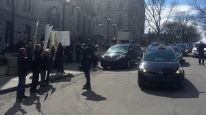 Taxi drivers protest outside the National Assembly as MNAs discuss legislation to regulate Uber (CTV Montreal/Maya Johnson)