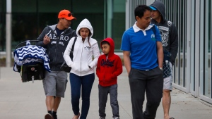 Evacuees from the Fort McMurray wildfires arrive at the evacuation centre in Edmonton on Thursday, May 5, 2016. (THE CANADIAN PRESS/Jeff McIntosh)