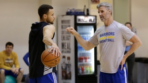 Golden State Warriors' Stephen Curry, left, speaks with player development coach Bruce Fraser during NBA basketball practice on Thursday, May 5, 2016, in Oakland, Calif. (AP / Ben Margot)