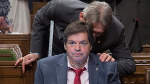 Hamilton Centre MP David Christopherson speaks with his friend Liberal MP for Ottawa-Vanier Mauril Belanger, who lives with ALS (also known as Lou Gherig's disease), after he defended his proposed changes to neutralize gender in the lyrics to 'O Canada' in the House of Commons on Parliament Hill in Ottawa on Friday, May 6, 2016. (Adrian Wyld / THE CANADIAN PRESS)