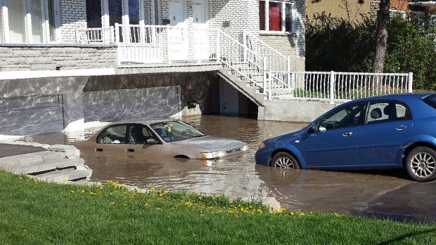 A water main broken by construction crews flooded homes on Bedard St. in Laval on Tuesday May 10, 2016 (CTV Montreal/Cosmo Santamaria)