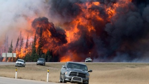 In this May 7, 2016 file photo, a wildfire burns south of Fort McMurray, Alberta. (Jonathan Hayward / The Canadian Press via AP)