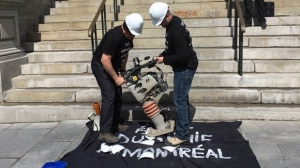 City engineers crushing construction hats in front of City Hall. They've been without a contract since 2011. (CTV Montreal/Stephane Giroux)