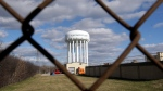 This March 21, 2016 file photo shows the Flint Water Plant water tower in Flint, Mich. (AP / Carlos Osorio, File)