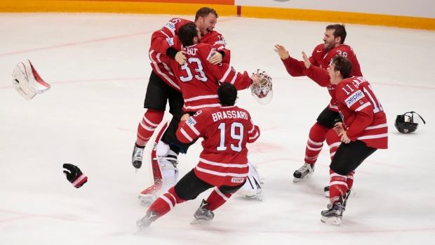 Canada's players celebrate the victory goal during the Ice Hockey World Championships final match between Finland and Canada, in Moscow, Russia, on Sunday, May 22, 2016. (AP / Ivan Sekretarev)