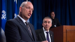Quebec Opposition public security critic Stephane Bergeron, left, speaks on the gun registry, as colleague Nicolas Marceau, right, looks on, at a news conference, Wednesday, March 23, 2016 at the legislature in Quebec City. (THE CANADIAN PRESS/Jacques Boissinot)