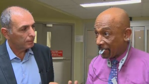 Former U.S. TV host Montel Williams is helping test - and back - and new experimental therapy for those with brain injuries.