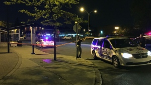 Police at the scene of a stabbing near Cote Vertu metro station on May 23, 2015 (CTV Montreal/Cosmo Santamaria)