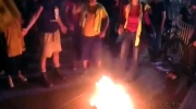 Trump protesters light fire at rally