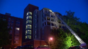 Montreal firefighters at an eight-storey apartment building in Outremont on May 25, 2016 (CTV Montreal/Cosmo Santamaria)